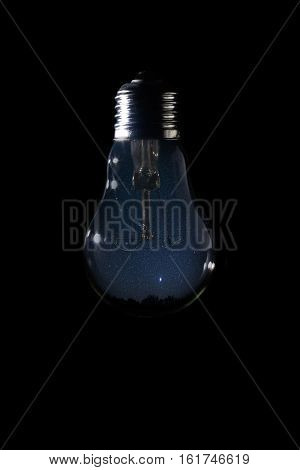 Beautiful Night Sky Inside Of Light Bulb On Dark Background.