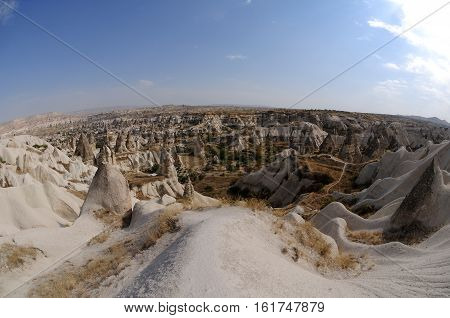 Panoramic View Of Unique Rock Formations In Valley Of Cappadocia In The Anatolian Region Of Central
