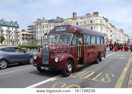 ST. LEONARDS-ON-SEA, ENGLAND - JULY 9, 2016: Guy Special vintage bus MXX 367 leads the parade along the seafront during the annual St.Leonards Festival. The bus was built in 1954 for London Transport.