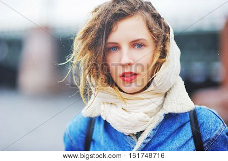 girl in a denim jacket with wet hair