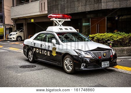 TOKYO, JAPAN - NOVEMBER 14, 2016: Japanese Police car on the street of Ikebukuro district of Tokyo. Tokyo Metropolis is both the capital and most populous city of Japan.