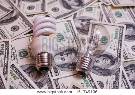 energy saving lamp incandescent fluorescent energy saving saving electricity money background Eco energy saving light bulb comparison of energy saving lamps and incandescent lamps