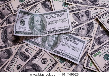 bill of one million dollars a new brilliant idea a million dollars the thirst for wealth success get rich millionaire background of the moneybackground of dollars old hundred-dollar bill face