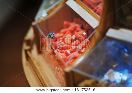 Colorful sweet jellies with sugar in a shop window in glass container