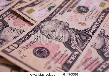 money background First Minister of the Treasury Alexander Hamilton on the hundred dollar bill the dollar's father ten-bill face the background of money