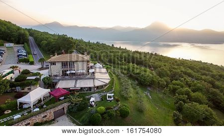 Costermano Italy - May 22 2016: Aerial view of the house of spirits famous restaurant in Costermano Lake Garda Italy.