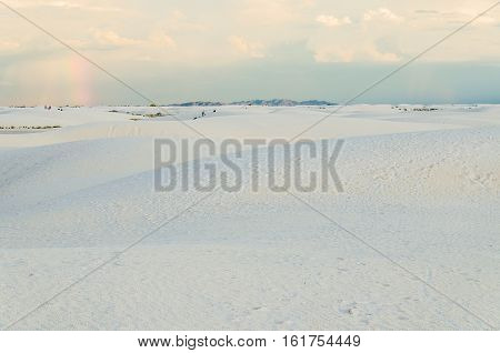 White sand dunes in New Mexico with rainbow