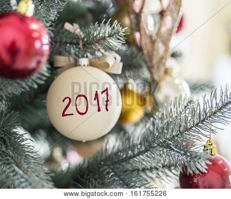 2017 written on Christmas ball. Christmas or New Year abstract.