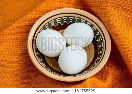 Eggs on the golden background. Top view. Close-up