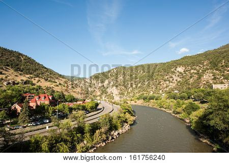 Glenwood Springs, USA - September 7 2015: Colorado river in downtown with highway