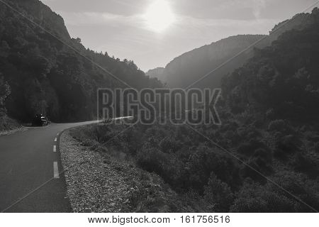 Empty winding mountain road in Provence. Provence-Alpes-Cote d'Azur France. Black and white image