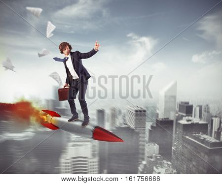Businessman flying on a rocket over the city. Increase the climb to success concept