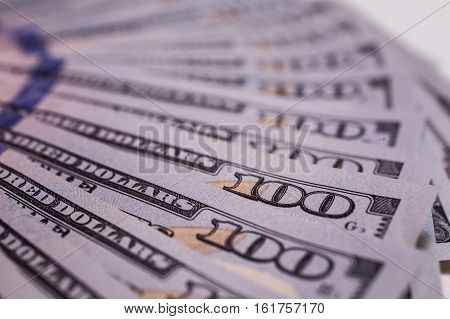 background of the money background of new hundred dollar bills front side. the evolution of the bill in one hundred dollars dollars currency isolated on white fan from american dollars banknotes
