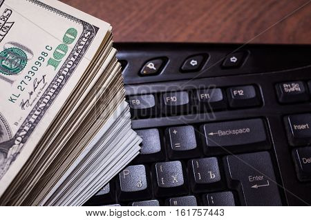 keyboard and money a place for records business plan money background hundred dollar bills front side. background of dollars new hundred-dollar bil face copyspace earnings in the Internet