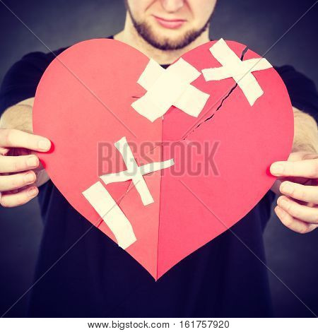 Very Sad Man Holding Broken Heart