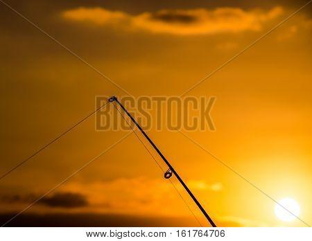 Fisherman Fishing Rod Silhouette at Orange Sunset