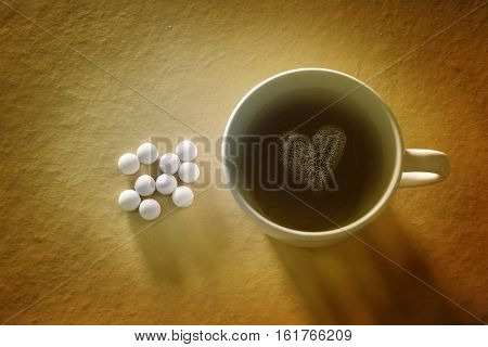 black coffee and aspirins pills hangover concept.