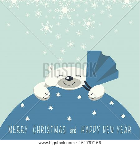Christmas card. The smiling polar bear is on the gift bag. Gift bag is blue. On the gift bag the phrase merry Christmas and a happy New year.
