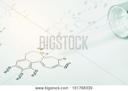 Laboratory glass Pipette on Chemical formula paper with light tone select focus
