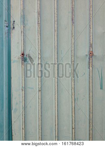 Rusted and pale green galvanized iron sheet