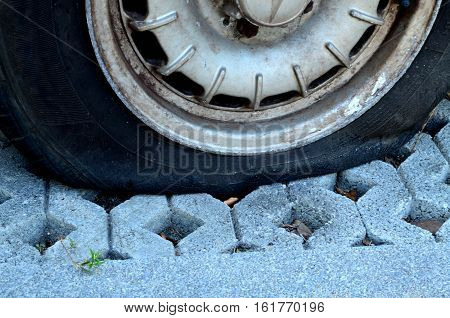 Close up flat tire of a car