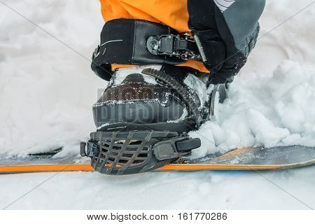 The Man In Black Boots Buttons Fastening Snowboard