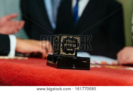 Hand Of Boy Reading The Jewish Torah At Bar Mitzvah