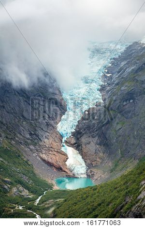 Briksdalsbreen or Briksdal glacier with a small glacial lake Briksdalsbrevatnet, a popular tourist attraction in Norway