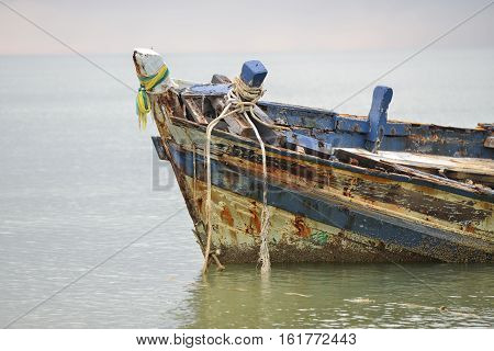 An old shipwreck or abandoned shipwreck. , Wrecked boat abandoned stand on beach Thailand.