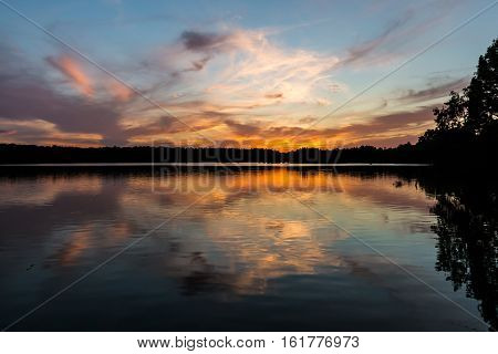 Stumpy Lake with brilliant orange sunset in Virginia Beach, Virginia.