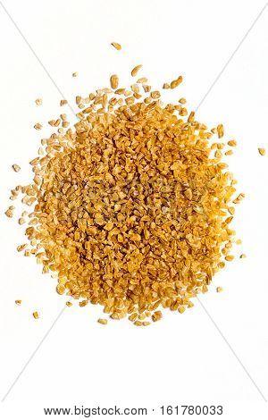 Pile of Bulgar wheat isolated on white background