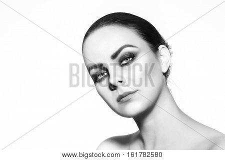 Black and white HD portrait of young beautiful woman over white background, cipy space