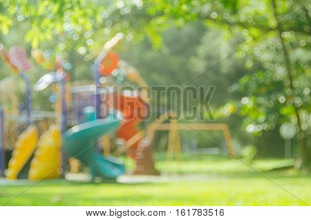 Blur Colorful Playground In Nature Green Park Abstract Background.