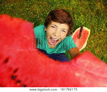 boy bite water melon smiling outdoor summer portrait