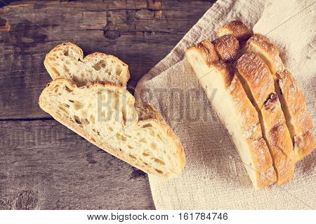 ciabatta fresh bread fresh ciabatta on the table. Italian ciabatta bread cut in slices.