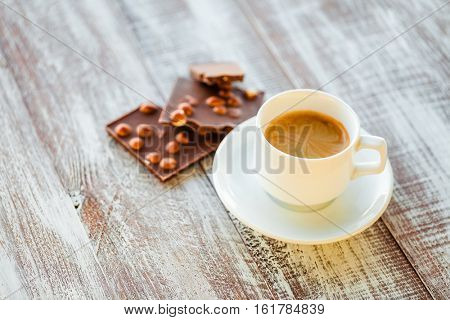 chocolate with coffee on a wooden white table