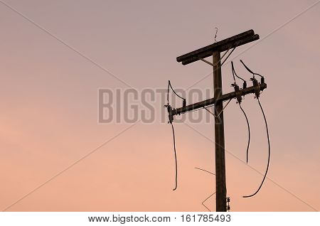 Copy Space Of Broken Electric Pole On Sunset Sky  Background.