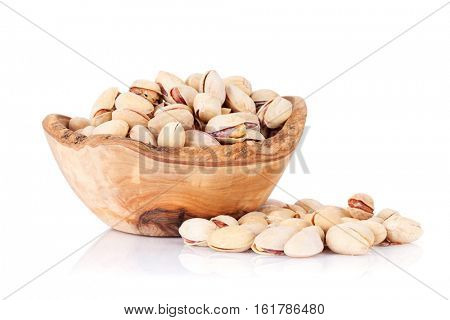 Pistachios nuts in bowl. Isolated on white background