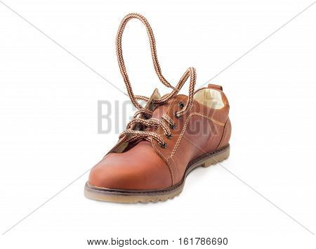 Synthetic shoelaces on brown mens shoe with an eyelets during lacing on a light background