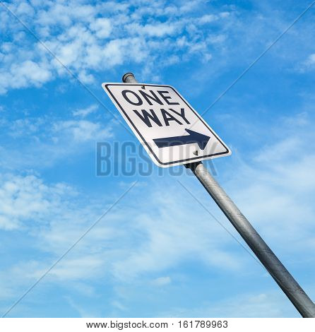 One way road sign on blue sky background