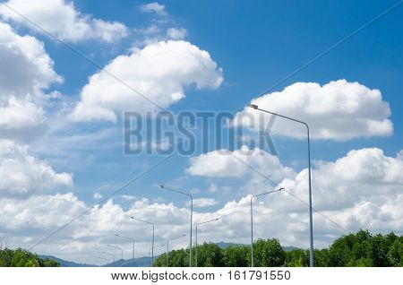 Copy Space Of Street Light Lamp With Blue Sky And White Clouds Background.