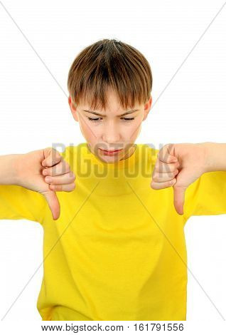 Sad Kid with Thumb Down Gesture Isolated on the White Background