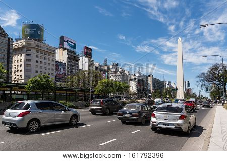 Buenos Aires, Argentina - October 30 2016: Obelisk and Avenida 9 de Julio with traffic car in Buenos Aires in a sunny day