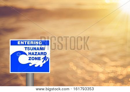 Warning Zone Tsunami Sign On Blur Tropical Sunset Beach Copy Space Abstract Backgroud.