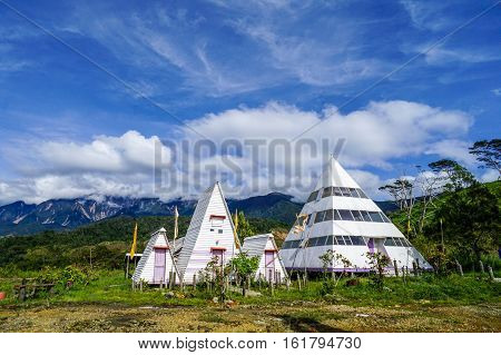 Ranau,Sabah-Dec 11,2016:Beautiful unique huts at the Mt Kinabalu Holiday Camp at Ranau,Sabah,Borneo.The visitor can enjoying a clear view of the majesty Mountain Kinabalu from the hut verandah.