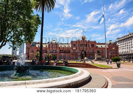 Buenos Aires, Argentina - Otober 30 2016: Casa Rosada in Plaza de Mayo in Buenos aires with tourist in a sunny day.