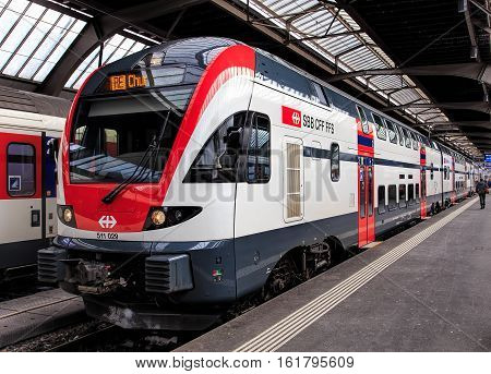 Zurich, Switzerland - 1 February, 2015: a passenger train at the platform of Zurich main railway station. Zurich main railway station is the largest railway station in Switzerland and one of the most busiest railway stations worldwide.