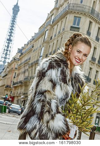 Happy Modern Fashion-monger With Christmas Tree In Paris, France