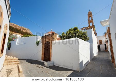 Narrow street and the front door of the small ancient Lindos town, Rhodes, Greece