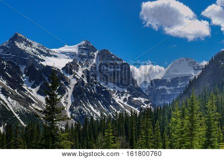 The mountain peaks around Lake Louise in Canada